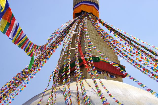 Prayer flags at the Boudhanath Stupa in Kathmandu. Buddhist walk around the stupa clockwise as a devotional practice.
