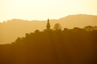 Swayambhunath, a Buddhist temple, on the horizon at sunset. I hope to tour the temple soon.