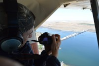 Senior Attorney, Miles Johnson, flying over McNary Dam. Aerial support from Lighthawk