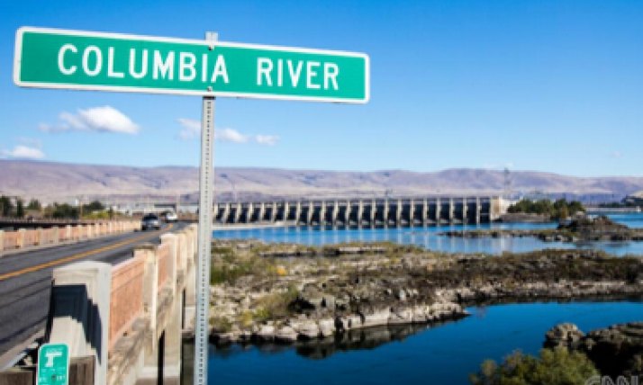 Bridge in front of Dam with Columbia River Sign
