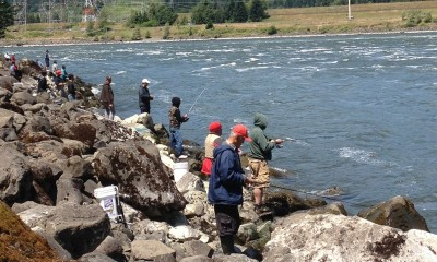 People fishing for shad near Bonneville Dam.